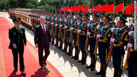 US Defense Secretary Jim Mattis and China's Defense Minister Wei Fenghe inspect and honor the guard during a welcoming ceremony at the Bayi Building in Beijing on June 27.