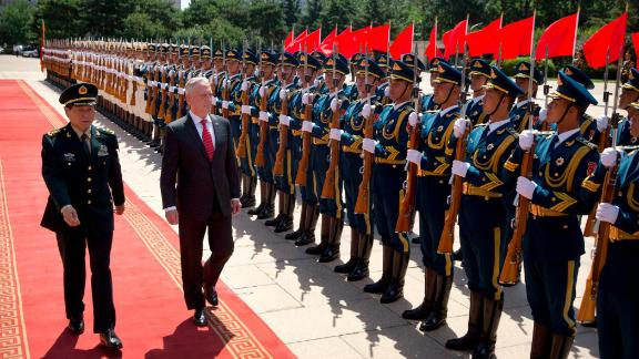 US Defence Secretary Jim Mattis and China's Defence Minister Wei Fenghe inspect and honour guard during a welcome ceremony at the Bayi Building in Beijing on June 27, 2018. (Photo by Mark Schiefelbein / POOL / AFP)        (Photo credit should read MARK SCHIEFELBEIN/AFP/Getty Images)