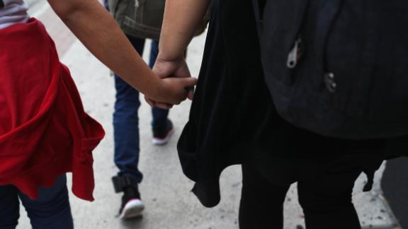 """Central American immigrant families depart ICE custody, pending future immigration court hearings on June 11, 2018 in McAllen, Texas. Thousands of undocumented immigrants continue to cross into the U.S., despite the Trump administration's recent """"zero tolerance"""" approach to immigration policy.  (Photo by John Moore/Getty Images)"""