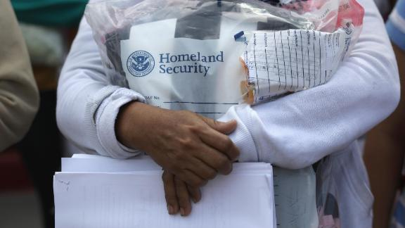 "Central American immigrants depart ICE custody, pending future immigration court hearings on June 11, 2018 in McAllen, Texas. Thousands of undocumented immigrants continue to cross into the U.S., despite the Trump administration's recent ""zero tolerance"" approach to immigration policy.  (Photo by John Moore/Getty Images)"