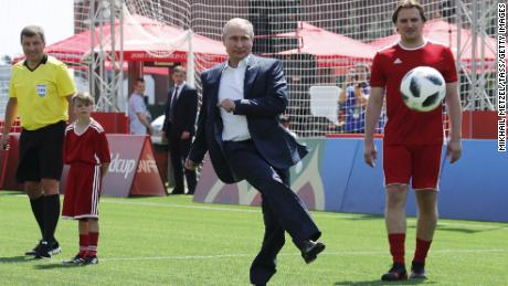 Putin has a go at the World Cup football park in Red Square.