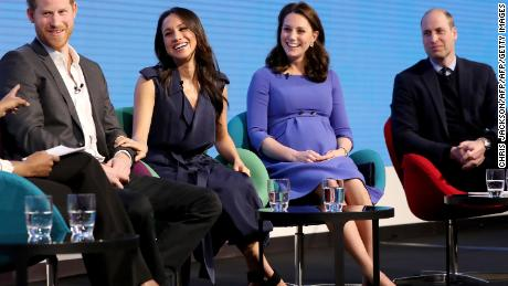 Prince Harry, Meghan Markle, Kate Middleton and Prince William share a stage.