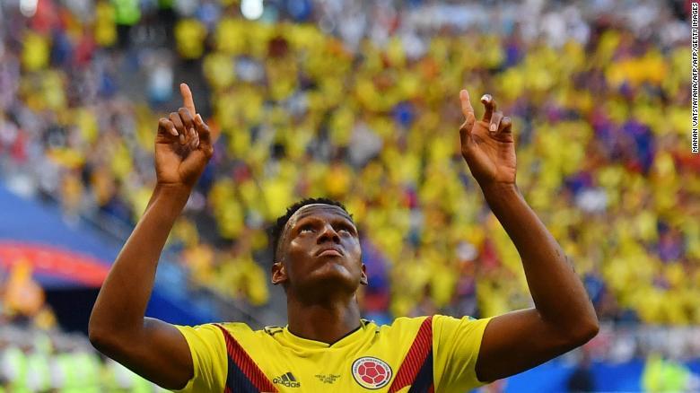 Yerry Mina celebrates his winning goal.