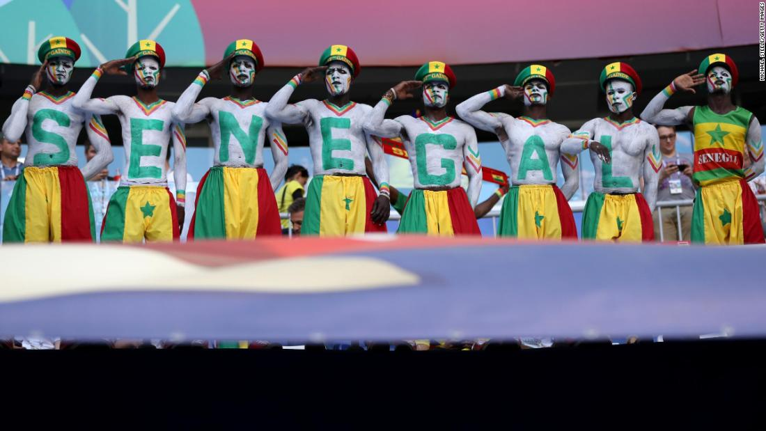 Senegal fans salute before the match against Colombia on Thursday, June 28.