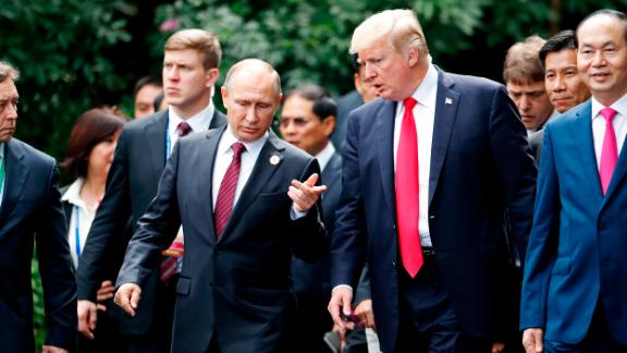 "US President Donald Trump (R) and Russia's President Vladimir Putin chat as they walk together to take part in the ""family photo"" during the Asia-Pacific Economic Cooperation (APEC) leaders' summit in the central Vietnamese city of Danang on November 11, 2017.