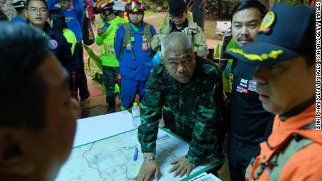 Thai officials plan over a map of the Tham Luang Nang Non caves.