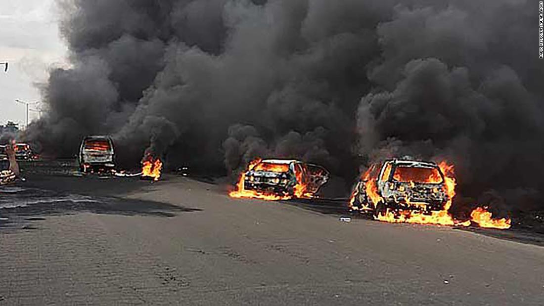 lagos nigeria fire kills at least 9 and sets dozens of cars ablaze