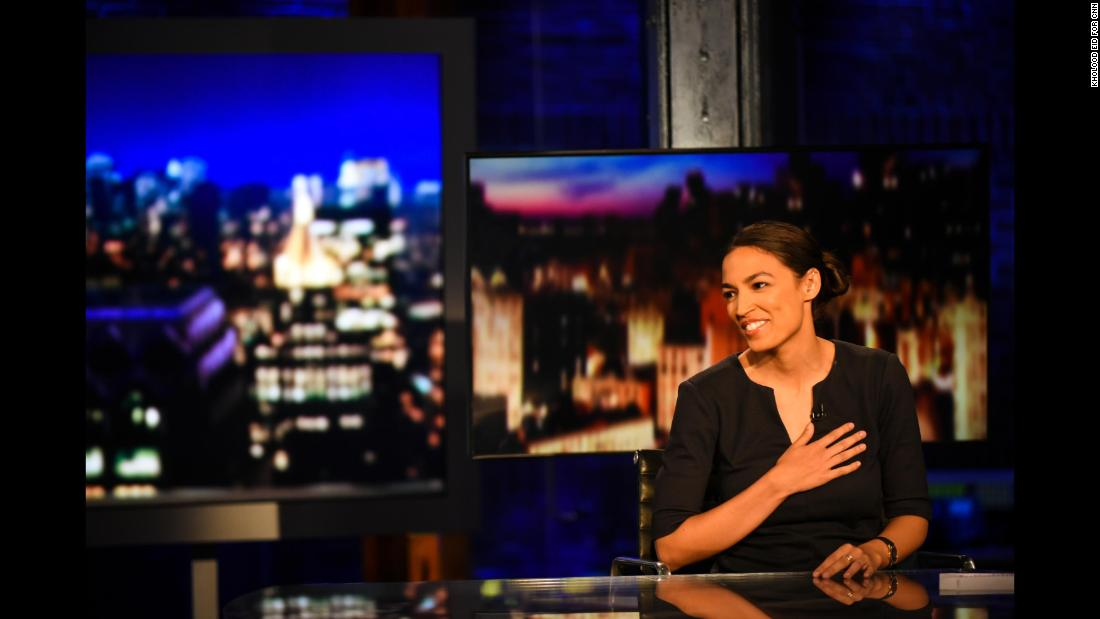 "Alexandria Ocasio-Cortez reacts to video during <a href=""https://www.youtube.com/watch?v=yGUplphAHDc"" target=""_blank"">an interview with CNN's Erin Burnett</a> on Wednesday, June 27. Ocasio-Cortez <a href=""https://www.cnn.com/2018/0627/politics/gallery/alexandria-ocasio-cortez/index.html"" target=""_blank"">pulled off the biggest upset</a> in Tuesday's primaries. In her first political campaign, the 28-year-old Latina and Democratic Socialist defeated US Rep. Joe Crowley, a 10-term incumbent in New York's 14th congressional district. <a href=""https://www.cnn.com/2018/06/26/politics/alexandria-ocasio-cortez-joe-crowley-new-york-14-primary/index.html"" target=""_blank"">Photos: A new face for the Democratic Party</a>"