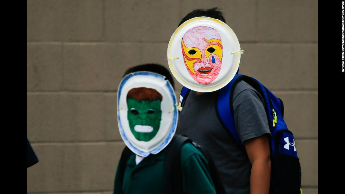 "Children wear masks as they exit a Cayuga Centers facility in New York City on Friday, June 22. <a href=""https://www.cnn.com/2018/06/20/politics/new-york-mayor-blasts-trump/index.html"" target=""_blank"">More than 200 migrant children were at the facility</a> after being separated from their families at the US-Mexico border. Cayuga Centers works with the federal government to help care for unaccompanied minors."