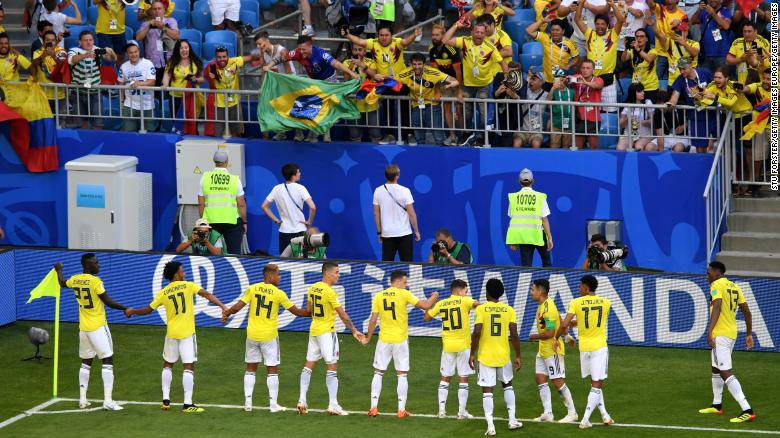 """Colombia attempt a """"wave"""" celebrations after Yerry Mina's goal."""