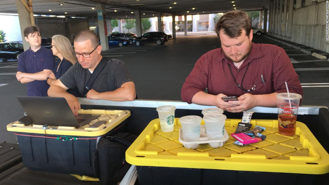 "Capital Gazette reporter Chase Cook, right, and photographer Joshua McKerrow work on the June 29th edition of the newspaper while awaiting news from their colleagues in Annapolis, Maryland, on Thursday, June 28. Five staff members of the paper <a href=""https://www.cnn.com/2018/06/29/us/inside-capital-gazette-newsroom-shooting/index.html"" target=""_blank"">were killed when a gunman opened fire</a> in the newsroom Thursday."