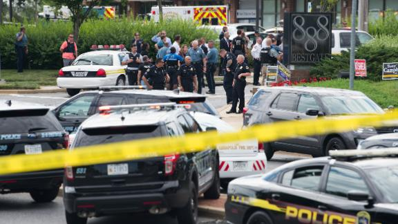 """Police respond to a shooting in Annapolis, Maryland, June 28, 2018. - Several people were feared killed Thursday in a shooting at the building that houses the Capital Gazette, a daily newspaper published in Annapolis, a historic city an hour east of Washington. A reporter for the Capital Gazette, Phil Davis, tweeted that a """"gunman shot through the glass door to the office and opened fire on multiple employees."""" He said several people were killed.""""There is nothing more terrifying than hearing multiple people get shot while you're under your desk and then hear the gunman reload,"""" Davis said. (Photo by SAUL LOEB / AFP)        (Photo credit should read SAUL LOEB/AFP/Getty Images)"""