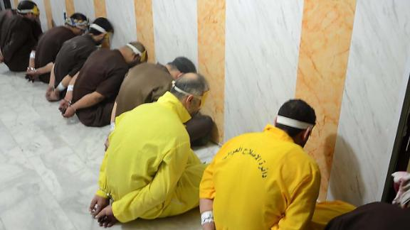 A handout picture released by the Iraqi Justice Ministry on Friday shows alleged ISIS fighters ahead of their execution.