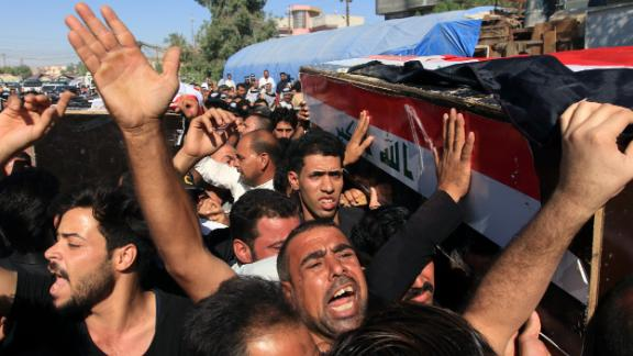 Iraqis carry the coffin of a victim who was kidnapped and then executed by Islamic state group in Karbala city, southern Iraq on Thursday.