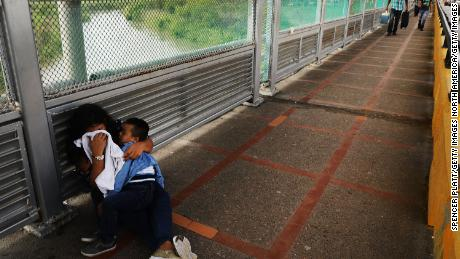 Trump reverses course on immigrant children, signs order to