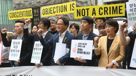 South Korean activists and conscientious objectors to military service seen outside the Constitutional Court in Seoul on June 28, 2018.