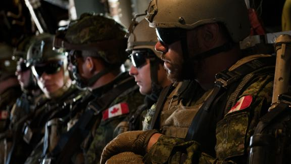 Members of the Canadian 2nd Battalion Royal 22e Régiment wait to take off during loading and offloading drills for the MV-22 Osprey during Rim of the Pacific exercises on Thursday.