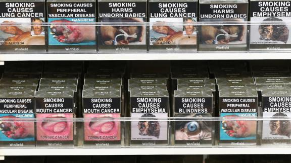 Cigarette packets with health warnings are displayed in a convenience store on August 1, 2013 in Sydney.