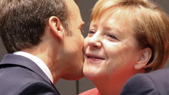 Emmanuel Macron kisses Angela Merkel during the last day of the European Union leaders' summit.