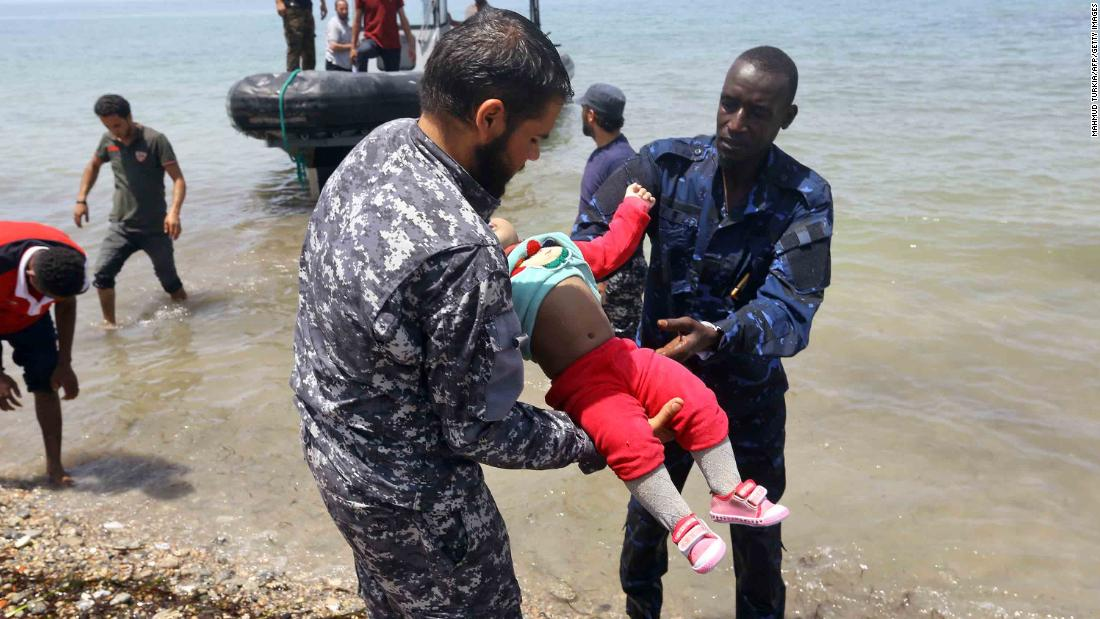 Members of the Libyan security forces carry the body of a baby ashore east of the capital Tripoli.
