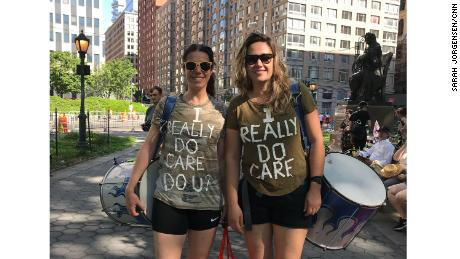 "Annie Scott, left, and Fernanda Kock wear ""I Really Do Care"" shirts at Saturday's rally in New York."
