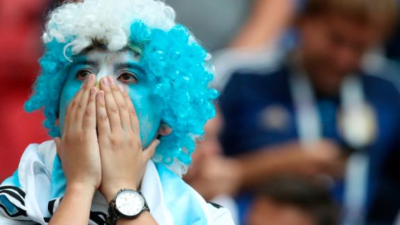 An Argentina fan reacts after the match.