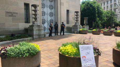 A sign was left outside the US Justice Department on Saturday in Washington.