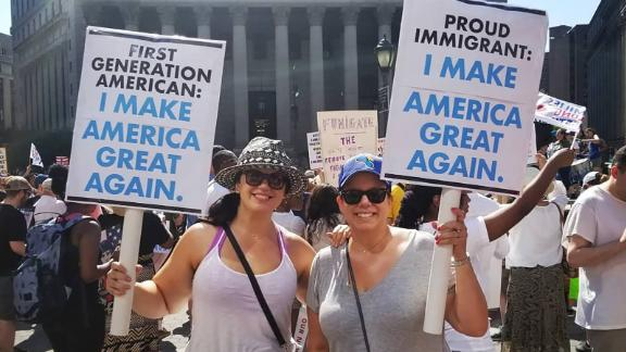 Elaine Alvarez, left, and sister Patty attend an immigration rally in New York.