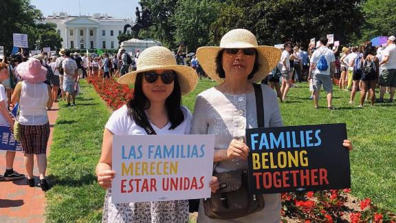 Erin Vong stands beside her mother, Felecia, at a protest in Washington.