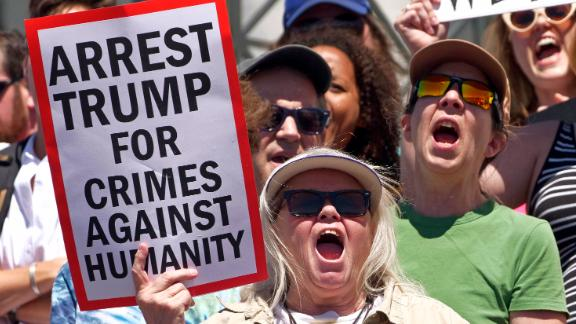 Salt Lake City: Activists hold signs Saturday to protest the Trump administration