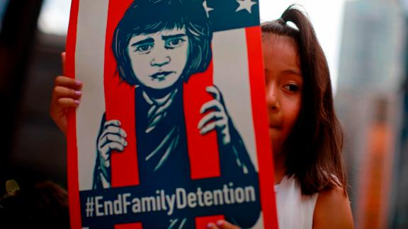 A girl takes part in a protest against the US  immigration policies separating migrant families in Chicago.