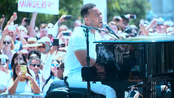 John Legend performs  for thousands  at the rally in Los Angeles.