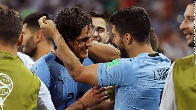 Cavani and Suarez celebrate Uruguay's winner.