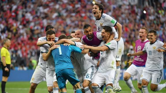 Russian players mob Akinfeev after the final save.