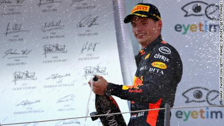 Race winner Max Verstappen of Netherlands and Red Bull Racing celebrates on the podium during the Formula One Grand Prix of Austria.