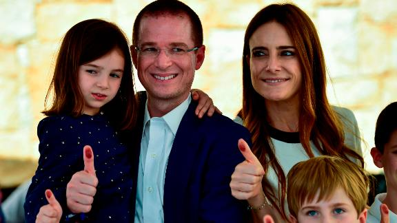 Ricardo Anaya and his family give their inked thumbs up after he cast his vote during in Queretaro.