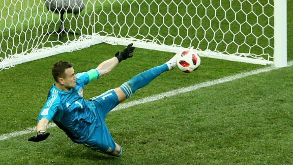 Goalkeeper Igor Akinfeev saves an Iago Aspas penalty to give Russia an upset victory over Spain in the round of 16. The match went to penalties after ending 1-1.
