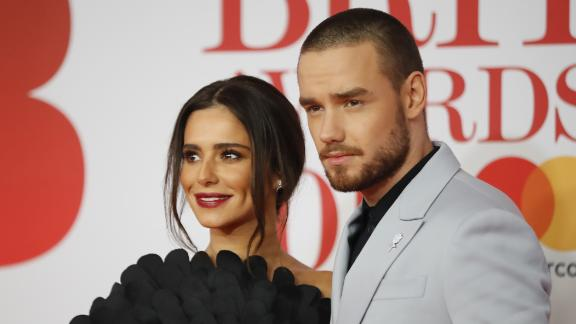British singer-songwriter Liam Payne and partner Cheryl pose on the red carpet on arrival for the BRIT Awards 2018 in London on February 21, 2018.