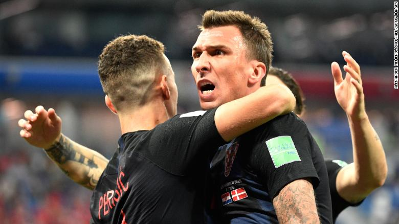 Mario Mandzukic (R) celebrates after scoring against Denmark.