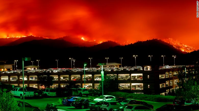 Flames from the County Fire burn above Cache Creek Casino Resort in Yolo County, California.
