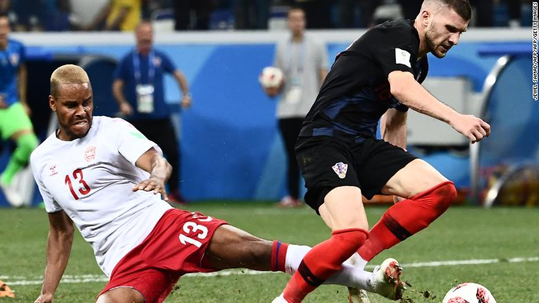Denmark's defender Mathias Jorgensen fouls Croatia's forward Ante Rebic (R) to give away a late penalty.