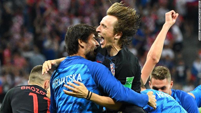 Croatia midfielder Luka Modric (top C) celebrates with teammates after Croatia defeated Denmark on penalties.