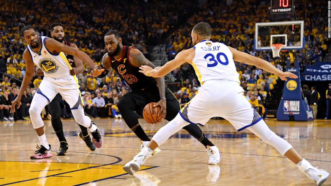 factory authentic ffad7 9c4cb James drives to the basket against Golden State Warriors guard Stephen  Curry and forward Kevin Durant. Photos  The rise of LeBron James