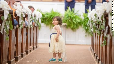 Skye Savren-McCormick performs her flower girl duties.