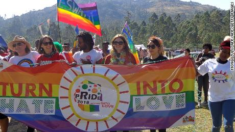 People take part in Swaziland's first ever pride parade in Mbabane on Saturday.