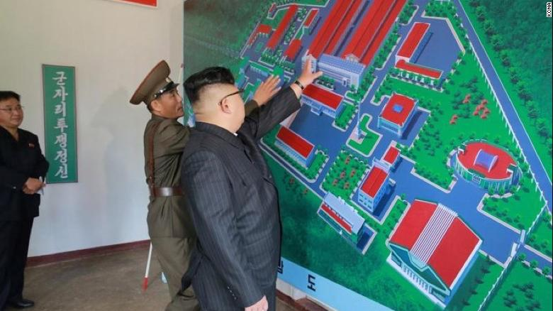 A photograph released by North Korean state media last year showing Kim inspecting an artist's rendition of the purported facility.