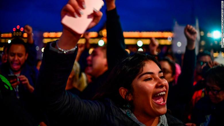 AMLO supporters react to his apparent victory in Mexico City on July 1.
