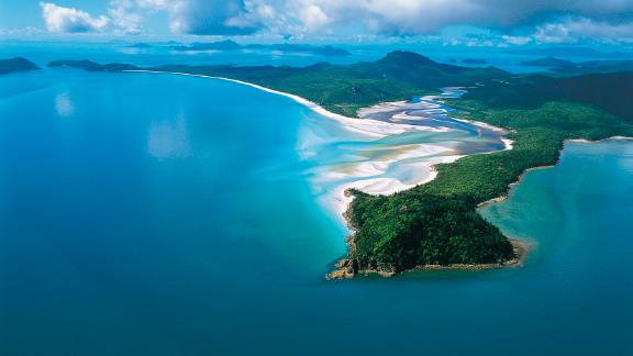 Australia, Whitsundays:  Between the coast of Queensland and the Great Barrier Reef snuggles Australia's very own chain of 74 tropical islands, including the world-famous Whitehaven Beach, a jaw-dropping curve of powder-white sand.
