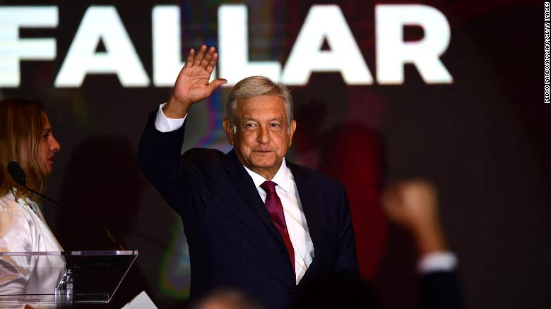 Newly elected Mexican President Andrés Manuel López Obrador greets his supporters in Mexico City on July 1, 2018. (Photo credit PEDRO PARDO/AFP/Getty Images)