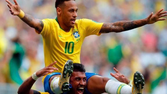 Neymar is held on Paulinho